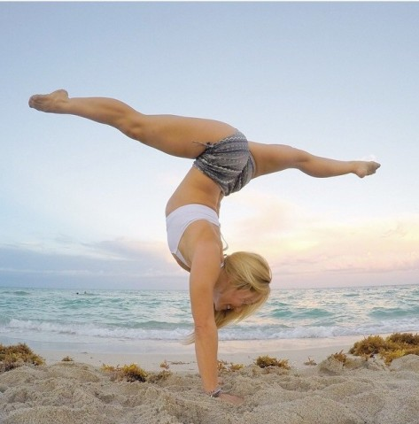 Kino Handstands on South Beach, courtesy of @kinoyoga